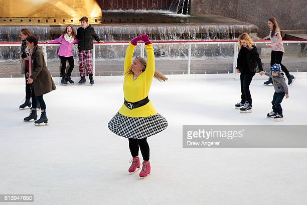People skate on the ice rink at Rockefeller Center October 11 2016 in New York City The iconic ice rink opened for its 80th season today