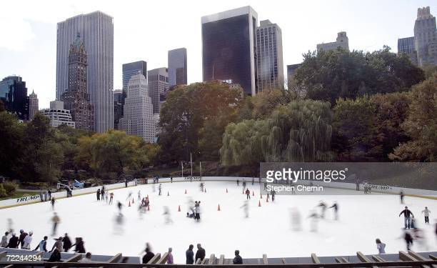 People skate on the Wollman Ice Rink October 23 2006 in Central Park in New York City The rink one of the country's largest outdoor skating rinks...