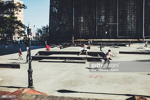 people skating at park - skateboard park stock pictures, royalty-free photos & images