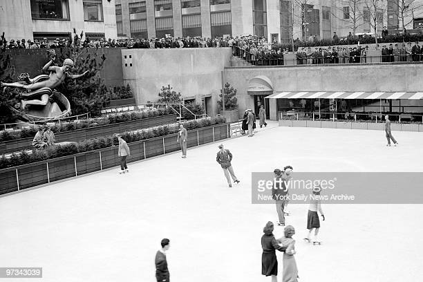 People skating at the opening of the Rockefeller Center roller skating rink