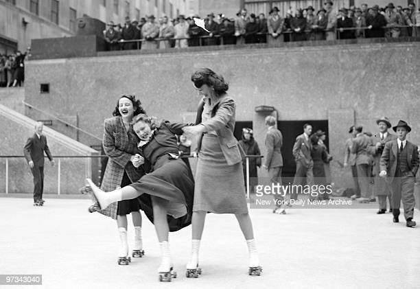 People skating at the opening of the Rockefeller Center roller skating rink.