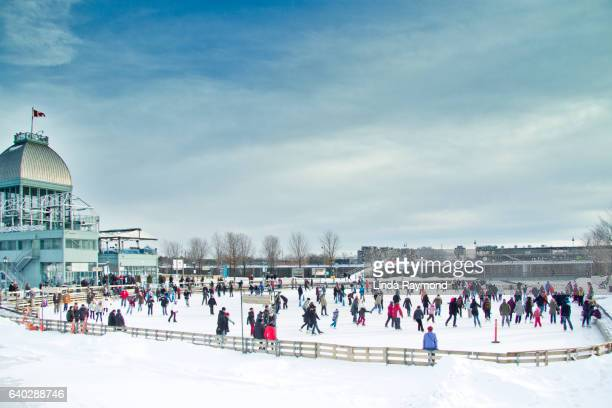people skating on ice rink in old port of montreal - ice rink stock photos and pictures