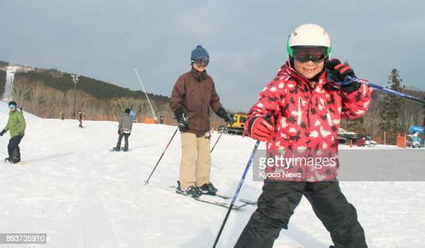 People ski and snowboard down a slope at Mineyama Kogen Resort White Peak on Dec 16 2017 The facility near the town of Kamikawa Hyogo Prefecture in...