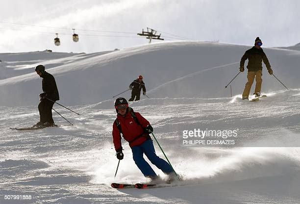 People ski down a slope on February 2 2016 in the French ski resort of Meribel at the junction with Les Menuires and Val Thorens in the 3 Valleys ski...