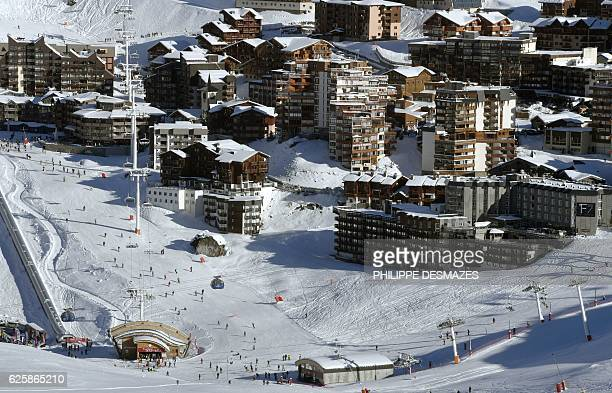 People ski down a slope on the opening weekend of the ski season on November 26 2016 at the Val Thorens ski resort in the French Alps / AFP /...