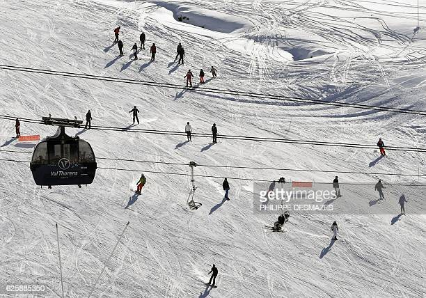 People ski down a slope on the opening weekend of the ski season on November 26 2016 at Val Thorens ski resort in the French Alps / AFP / PHILIPPE...