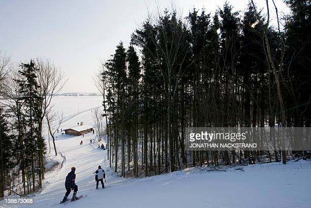 People ski down the Bornholm Ski Hill on February 4 2012 near the village of Godhjem on the Danish island of Bornholm which lies in the Baltic Sea...