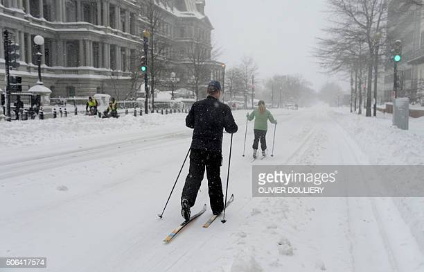 TOPSHOT People ski in front of the Eisenhower Executive Office Building in Washington on January 23 2016 A deadly blizzard with bonechilling winds...