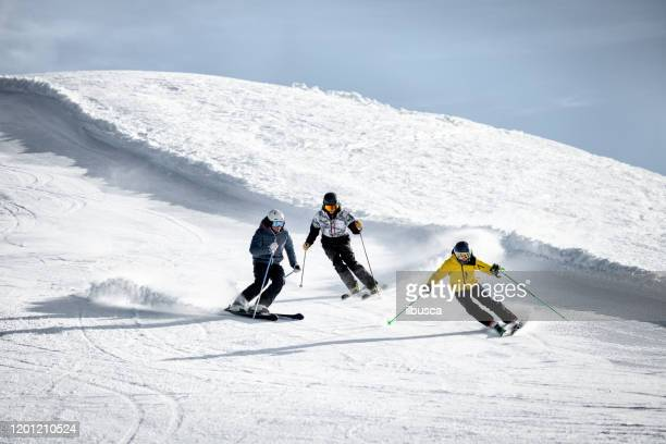 people skiing in alps ski resort, alpe di mera, piedmont, italy - piedmont italy stock pictures, royalty-free photos & images