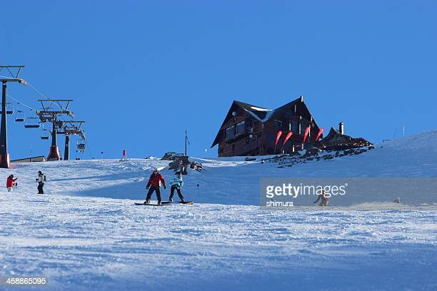 People skiing in front of Lynch Refuge 2- Andes Patagonia