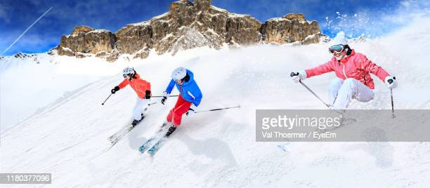 people skiing on snow covered land - lech stock pictures, royalty-free photos & images