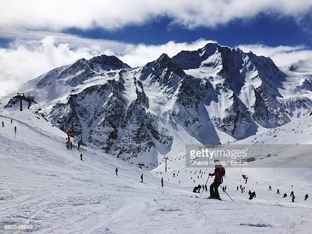 People Skiing On Snow Covered Landscape