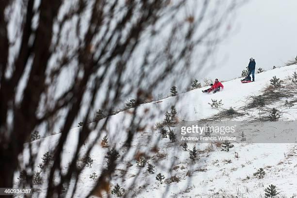 People sled on Centennial Park in Etobicoke January 5 2014