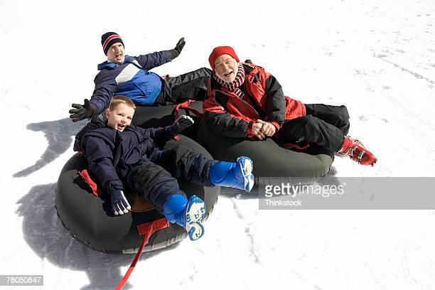 People sledding in inner tubes