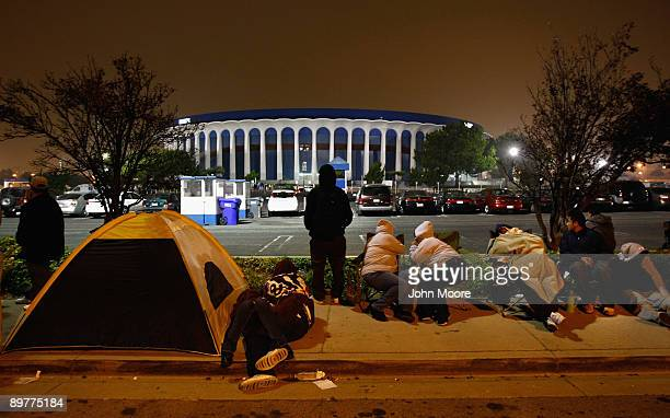 People sleep and camp out overnight near the Forum arena to get tickets for a free health clinic on August 13, 2009 in Inglewood, California. From...