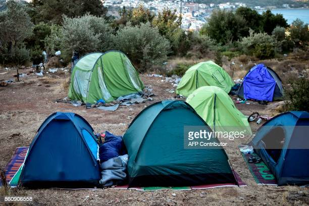 People sleep in tents near the overcrowded hotspot on the Greek eastern Aegean islands of Samos on October 13 2017 More than 3000 people on Samos are...