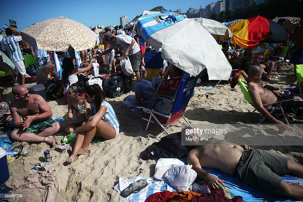 People sleep on Copacabana Beach while waiting to watch the 2014 FIFA World Cup final match pitting Argentina against Germany on July 13, 2014 in Rio de Janeiro, Brazil. The match will be held at the famed Maracana stadium.