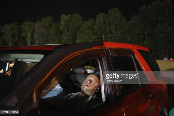 People sleep overnight in their cars to receive healthcare services at a free clinic on July 22 2017 in Wise Virginia Hundreds of Appalachia...