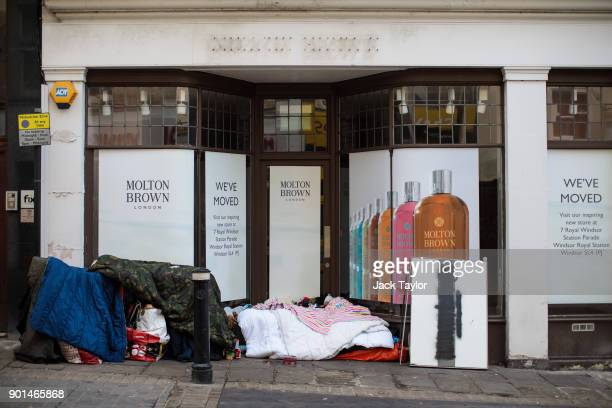 People sleep rough in a doorway by Windsor Castle on January 5 2018 in Windsor England British Prime Minister Theresa May has publicly challenged...