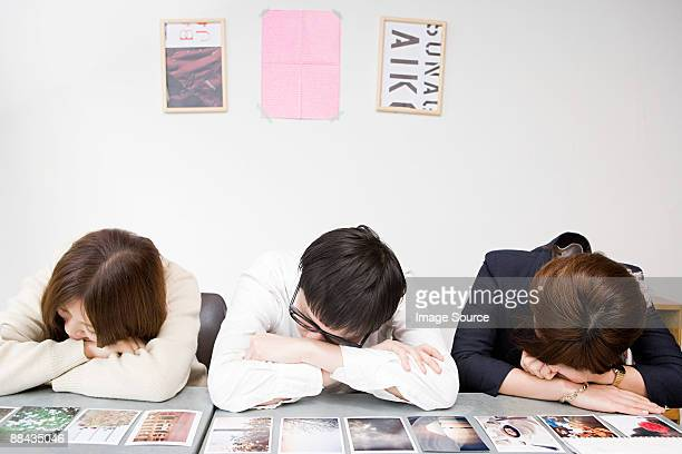 People sleeping by photographs