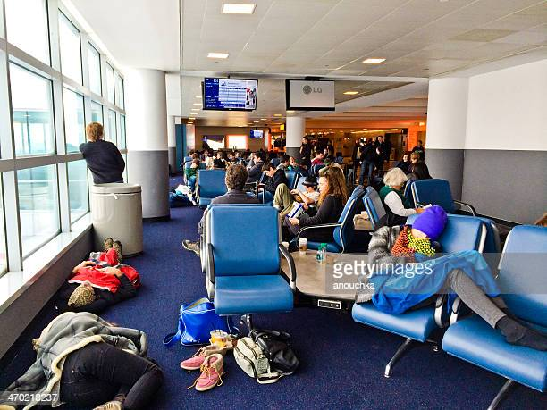 People sleeping on the floor at JFK Airport, New York