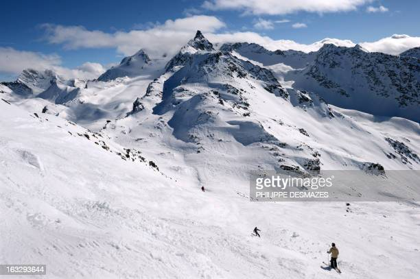 People slide on a free slope despite a high avalanche risk at the French ski resort of Meribel in the French Alps on March 7 2013 AFP PHOTO /...