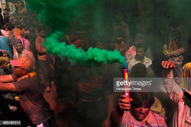 People smeared in colours celebrate Holi on a street outside the Bankey Bihari temple on March 6 2015 in Vrindavan India Festival of colors fun and...