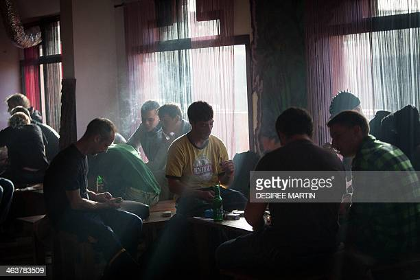 People smoke cannabis during a meeting of members and guests of the cannabis association ACMEFUR in celebration of San Canuto's day on the Spanish...