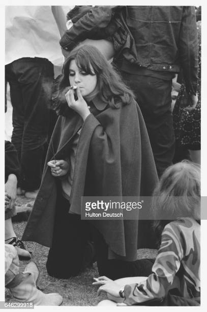 People smoke drugs at a hippy convention at Alexandra Palace London