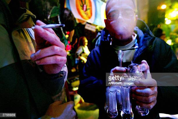 People smoke hash at the yearly High Times Cannabis Cup in Amsterdam 23 November 2003 At the High Times Cannabis Cup which started Sunday and lasts...