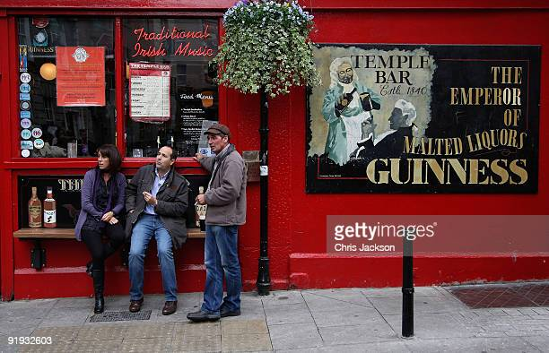 People smoke ouside the Temple Bar pub in Temple Bar on October 15 2009 in Dublin Ireland Dublin is Ireland's capital city located near the midpoint...
