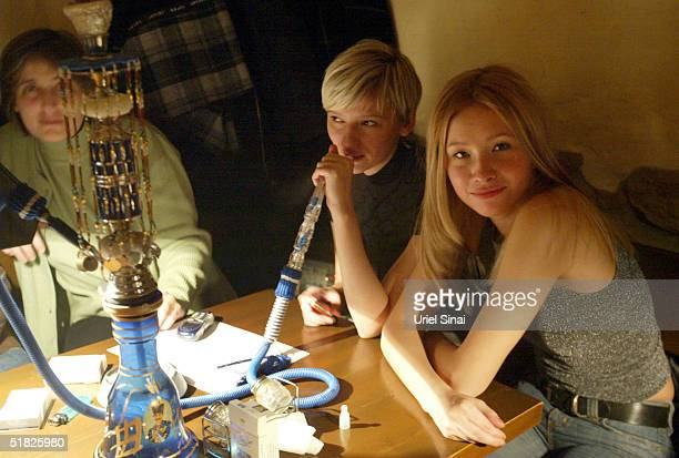 People smoke out of a hookah at a bar December 5 2004 in Donetsk Ukraine The city with a population of over 1 million is situated in the southeast of...
