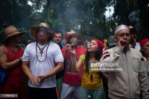 People smoke tobacco to ask María Lionza for her entrance to the mountain and to be able to pay her offering during a congregation of thousands of...