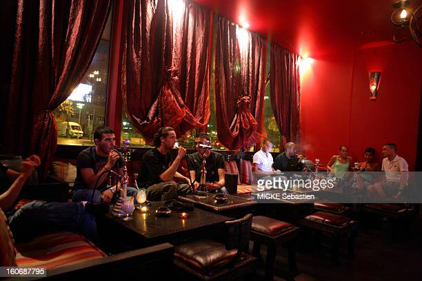 People smoking the shisha in the salons of Riyadh alMadina at 4 allee Vivaldi in the IInd district of PARIS