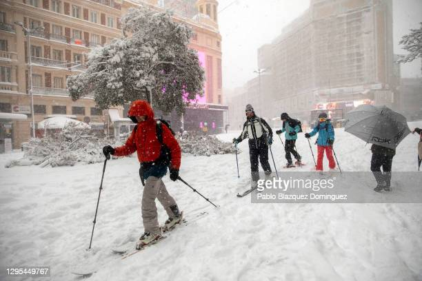 People snow ski at Plaza Callao during heavy snowfall on January 09, 2021 in Madrid, Spain. Spain is on red alert for a second day due to storm...