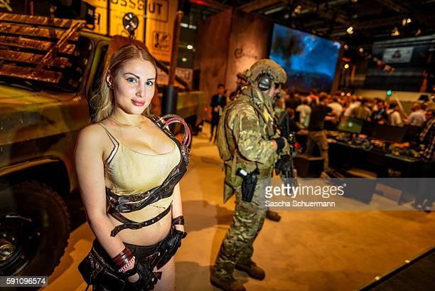 People socalled Cosplay play at the Gamescom 2016 gaming trade fair during the media day on August 17 2016 in Cologne Germany Gamescom is the world's...