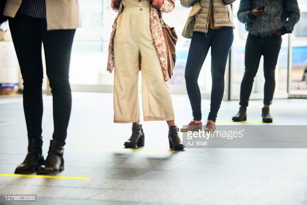people social distancing while standing in a line - south africa stock pictures, royalty-free photos & images