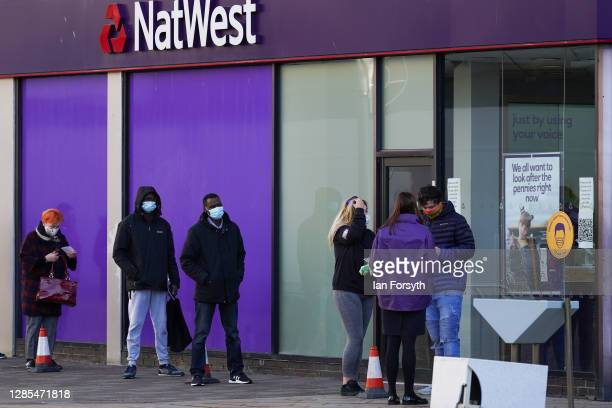 People socially distance as they wait to enter the Natwest bank in Hull city centre on November 13, 2020 in Hull, England. Hull recorded 726.8 new...