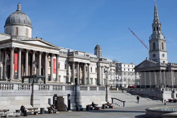 People 'socially distance' themselves from one another outside the National Gallery on March 24, 2020 in London, England. British Prime Minister,...