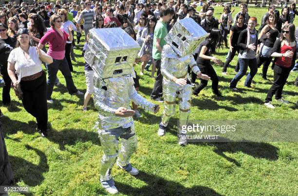 People, some dressed as robots, smash the offical Guinness World Record attempt for robot dancing at the University of Melbourne, on September 29...