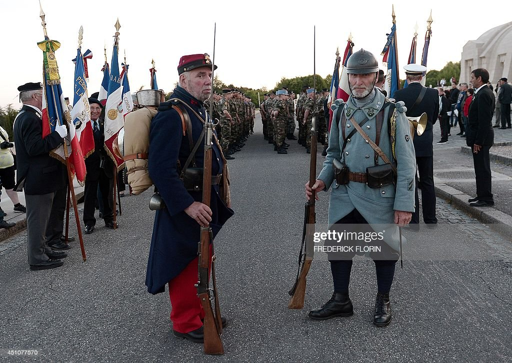 People, some wearing WWI period uniforms including French