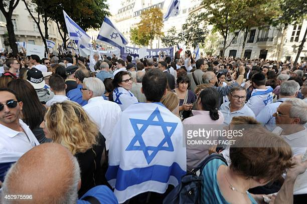 People some wrapped in Israel's national flag others waving the flag participate in a proIsrael demonstration called by the Representative Council of...