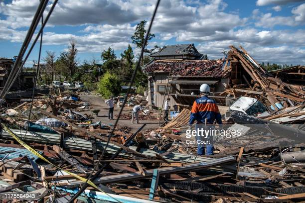 People sort through the debris of buildings that were destroyed by a tornado shortly before the arrival of Typhoon Hagibis on October 13 2019 in...