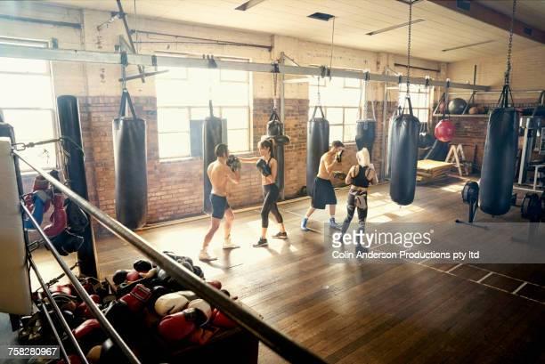 People sparring in gymnasium