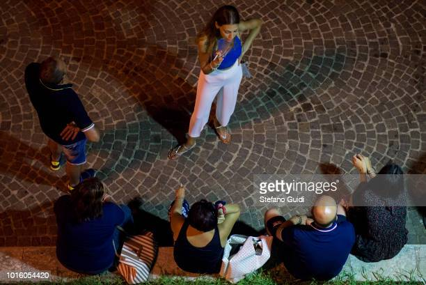 People speak seats on a wall of the Via Marina during the nightlife in the Via Marina The Via Marina of Reggio Calabria consists of the four streets...