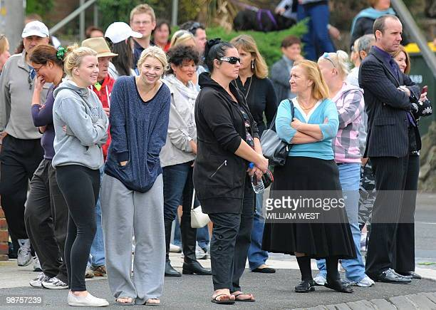 People spectate at the funeral service of slain gangland killer Carl Williams, in Melbourne on April 30, 2010. Carl Williams was bashed to death in...