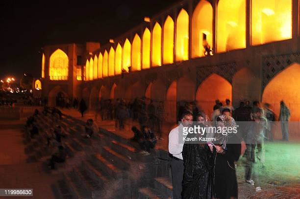 People spend a cool spring evening on Khaju Bridge, arguably the finest bridge in the province of Isfahan, Iran. It was built by the Persian Safavid...