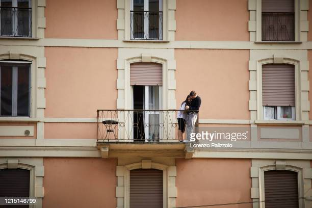 People spend a lot of time on balconies or looking out of windows due to quarantine restrictions during the COVID-19 pandemic on March 27, 2020 in...