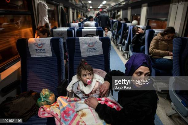People spend the night in a train which Turkish State Railways open their parked trains to host the earthquake survivors at Elazig's main station on...