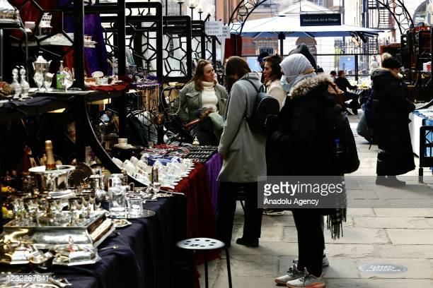 People spend time shopping after the country enters the second stage of the government's roadmap out of the countryâs third nationwide lockdown...